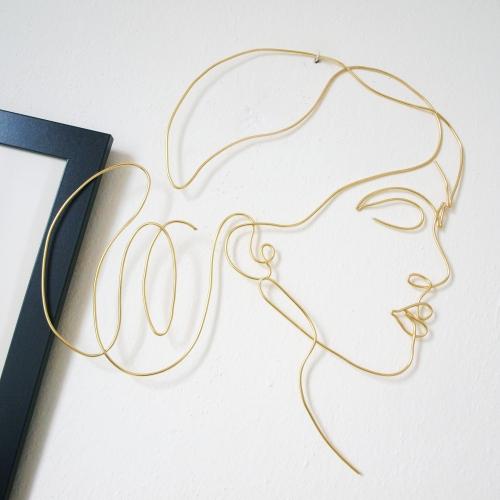 Hlava ženy - zlatý drát